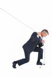 Αριστοκρατικός επιχειρηματίας που τραβά ένα σχοινί στοκ φωτογραφία με δικαίωμα ελεύθερης χρήσης