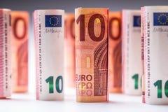 Αρκετά ευρο- τραπεζογραμμάτια που συσσωρεύονται από την αξία Ευρο- τραπεζογραμμάτια ρόλων Ευρο- χρήματα νομίσματος Στοκ Εικόνες