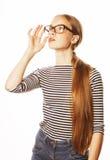 Αρκετά νέα επιχειρησιακή γυναίκα στα γυαλιά στο λευκό Στοκ Φωτογραφία