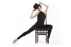 Αρκετά νέα συνεδρίαση ballerina στην έδρα Στοκ φωτογραφία με δικαίωμα ελεύθερης χρήσης
