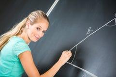 Αρκετά νέος δάσκαλος δημοτικών σχολείων/κολλεγίων Στοκ Φωτογραφίες