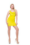 Αρκετά ψηλή γυναίκα στο κοντό κίτρινο φόρεμα που απομονώνεται Στοκ Φωτογραφία