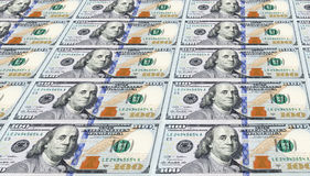 Αρκετές από τις πρόσφατα σχεδιασμένες ΗΠΑ Εκατό δολάριο Bill. Στοκ Εικόνες