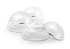 Αρκετοί άσπρο στρογγυλευμένο καλλυντικό βάζο Στοκ εικόνα με δικαίωμα ελεύθερης χρήσης