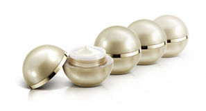 Αρκετοί χρυσό καλλυντικό βάζο σφαιρών στο λευκό Στοκ εικόνες με δικαίωμα ελεύθερης χρήσης