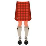 Αρσενικά πόδια στη σκωτσέζικη φούστα Στοκ Εικόνα