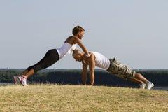 Αρσενική και θηλυκή άσκηση Στοκ Φωτογραφία