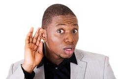 Αρσενική όμορφη ακρόαση επιχειρηματιών. Χέρι στο αυτί. στοκ εικόνες με δικαίωμα ελεύθερης χρήσης