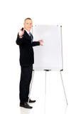 Αρσενικός ανώτερος υπάλληλος με το δείκτη που δείχνει σε κάποιο Στοκ Εικόνα