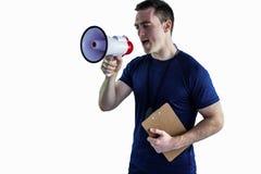 Αρσενικός εκπαιδευτής που φωνάζει μέσω megaphone Στοκ Φωτογραφία