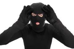 Αρσενικός κλέφτης που κοιτάζει μέσω ενός φανταστικού παραθύρου Στοκ φωτογραφία με δικαίωμα ελεύθερης χρήσης