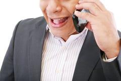 Αρσενικό εκτελεστικό να φωνάξει στο κινητό τηλέφωνό του Στοκ Εικόνα