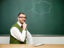 Αρσενικό nerd που σκέφτεται Στοκ Εικόνες