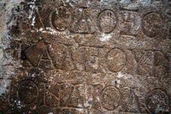 Αρχαία αλφάβητα στο μαρμάρινο υπόβαθρο Στοκ Εικόνες