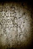 Αρχαία αλφάβητα στο μαρμάρινο υπόβαθρο Στοκ εικόνα με δικαίωμα ελεύθερης χρήσης
