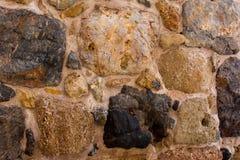 Αρχαίος τοίχος πετρών ενός αρχαίου φρουρίου Τεκτονική των παλαιών πετρών και των τούβλων Όμορφη ανασκόπηση Στοκ εικόνες με δικαίωμα ελεύθερης χρήσης