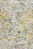 αρχαίος τοίχος πετρών Τεκτονική των παλαιών μικρών πετρών και των τούβλων Όμορφη ανασκόπηση Στοκ εικόνα με δικαίωμα ελεύθερης χρήσης