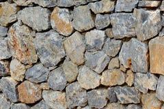Αρχαίος τοίχος πετρών του φρουρίου Τεκτονική των παλαιών πετρών και των τούβλων ανασκόπηση ασυνήθιστη Στοκ Εικόνα