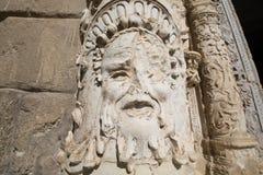 Αρχαίο γλυπτό προσώπου στο μουσείο προσόψεων Santa Cruz στο Τολέδο Στοκ Εικόνες