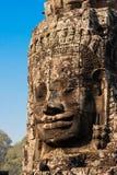 Αρχαίο πρόσωπο χαμόγελου πετρών του ναού Prasat Bayon Wat στη ζούγκλα, Angkor wat, Καμπότζη Το Angkor Wat είναι το μεγαλύτερο Στοκ Εικόνα