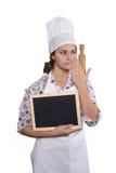 Αρχιμάγειρας γυναικών με τον πίνακα κιμωλίας Στοκ Εικόνα