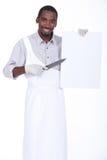 Αρχιμάγειρας με ένα αιχμηρό μαχαίρι Στοκ Φωτογραφία