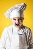 Αρχιμάγειρας μικρών παιδιών σε ομοιόμορφο Στοκ Φωτογραφία