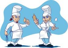 αρχιμάγειρες που μαγειρεύουν δύο Στοκ εικόνα με δικαίωμα ελεύθερης χρήσης