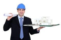 Αρχιτέκτονας με τα κυλώ-επάνω σχέδια στοκ φωτογραφία με δικαίωμα ελεύθερης χρήσης