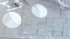 Αρχιτεκτονικά σχέδια σε έναν πίνακα απόθεμα βίντεο