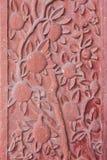 Αρχιτεκτονική λεπτομέρεια των χαρασμένων λουλουδιών Στοκ εικόνα με δικαίωμα ελεύθερης χρήσης