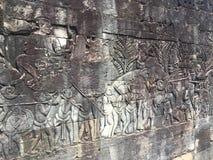 Αρχιτεκτονική της Καμπότζης Bas-ανακούφιση που απεικονίζει τα ιστορικές γεγονότα και τις καθημερινές ζωές Γλυπτική τοίχων του Khm Στοκ Φωτογραφία