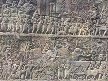 Αρχιτεκτονική της Καμπότζης Bas-ανακούφιση που απεικονίζει τα ιστορικές γεγονότα και τις καθημερινές ζωές Γλυπτική τοίχων του Khm Στοκ φωτογραφία με δικαίωμα ελεύθερης χρήσης