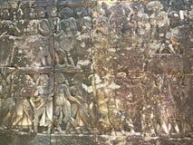 Αρχιτεκτονική της Καμπότζης Bas-ανακούφιση που απεικονίζει τα ιστορικές γεγονότα και τις καθημερινές ζωές Γλυπτική τοίχων του Khm Στοκ Φωτογραφίες