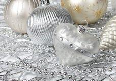 ασήμι καρδιών Χριστουγένν&ome Στοκ Φωτογραφίες