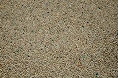 Ασβεστοκονίαμα τοίχων το μικρό αμμοχάλικο και τα κεραμικά κομμάτια που παρεμβάλλονται με σε το στοκ εικόνα