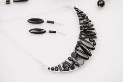 Ασημένια κοσμήματα με τις πέτρες onyx Στοκ Εικόνες