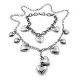 Ασημένιες καθορισμένες καρδιές - ασήμι, ανοξείδωτο, άσπρος χρυσός - περιδέραιο και βραχιόλι Στοκ Φωτογραφία