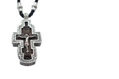 Ασημένιος ορθόδοξος σταυρός στο άσπρο υπόβαθρο στοκ φωτογραφία