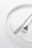 Ασημικές σε ένα στρογγυλό πιάτο Στοκ Εικόνα