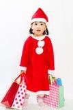Ασιάτης λίγος Άγιος Βασίλης με την τσάντα αγορών Στοκ εικόνες με δικαίωμα ελεύθερης χρήσης