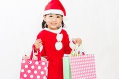 Ασιάτης λίγος Άγιος Βασίλης με την τσάντα αγορών Στοκ φωτογραφία με δικαίωμα ελεύθερης χρήσης