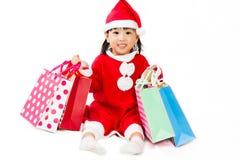 Ασιάτης λίγος Άγιος Βασίλης με την τσάντα αγορών Στοκ Εικόνες