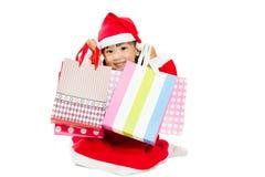 Ασιάτης λίγος Άγιος Βασίλης με την τσάντα αγορών Στοκ φωτογραφίες με δικαίωμα ελεύθερης χρήσης