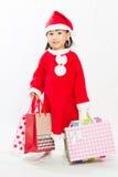Ασιάτης λίγος Άγιος Βασίλης με την τσάντα αγορών Στοκ Εικόνα