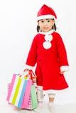 Ασιάτης λίγος Άγιος Βασίλης με την τσάντα αγορών Στοκ Φωτογραφία