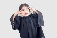 Ασιατικά χέρι νίκης κοριτσιών και πρόσωπο σεβασμού Στοκ Εικόνα