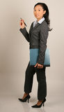 ασιατική γυναίκα κοστουμιών εκθέσεων επιχειρησιακής εκμετάλλευσης Στοκ Εικόνες
