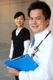 ασιατική νοσοκόμα γιατρών ανασκόπησης Στοκ εικόνα με δικαίωμα ελεύθερης χρήσης