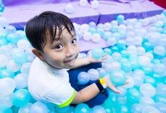 Ασιατική παιδική χαρά αγοριών Στοκ εικόνα με δικαίωμα ελεύθερης χρήσης